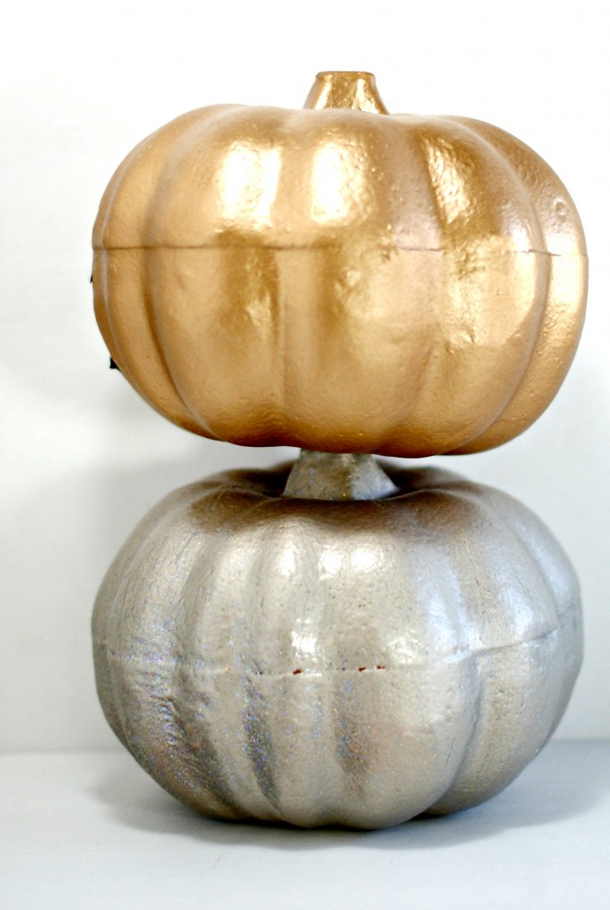 Spray painted pumpkins from the dollar store via CleverPinkPirate.com
