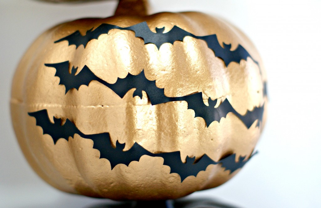 Spray painted gold dollar store pumpkin w/ vinyl bats for Halloween