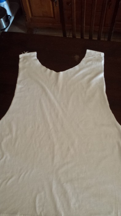 How to cut a t-shirt into a tank top.